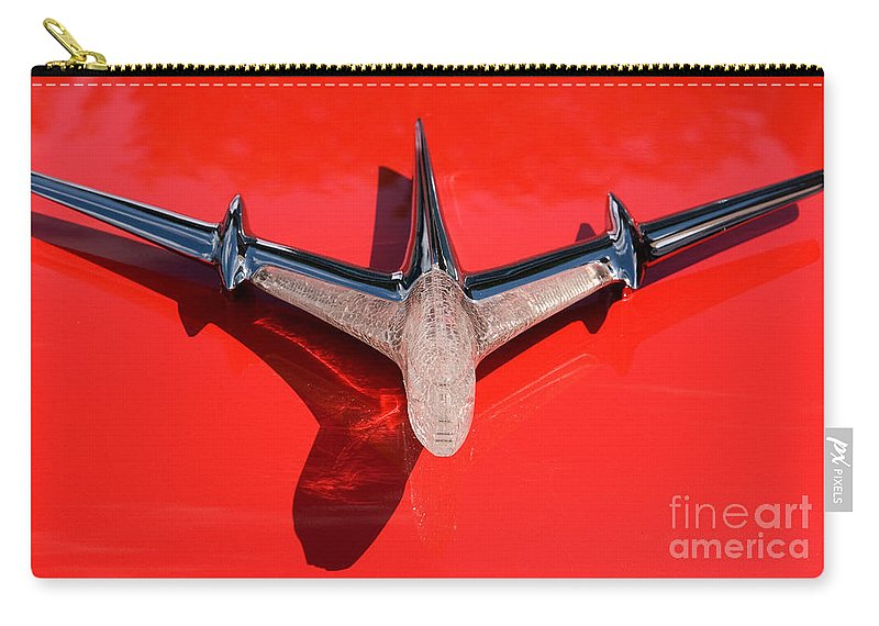 Car Carry-all Pouch featuring the photograph Emblem On Red by Vivian Christopher