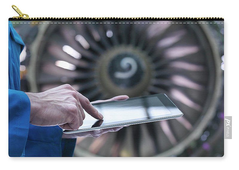 Focus Carry-all Pouch featuring the photograph Engineer Using Digital Tablet In Front by Monty Rakusen