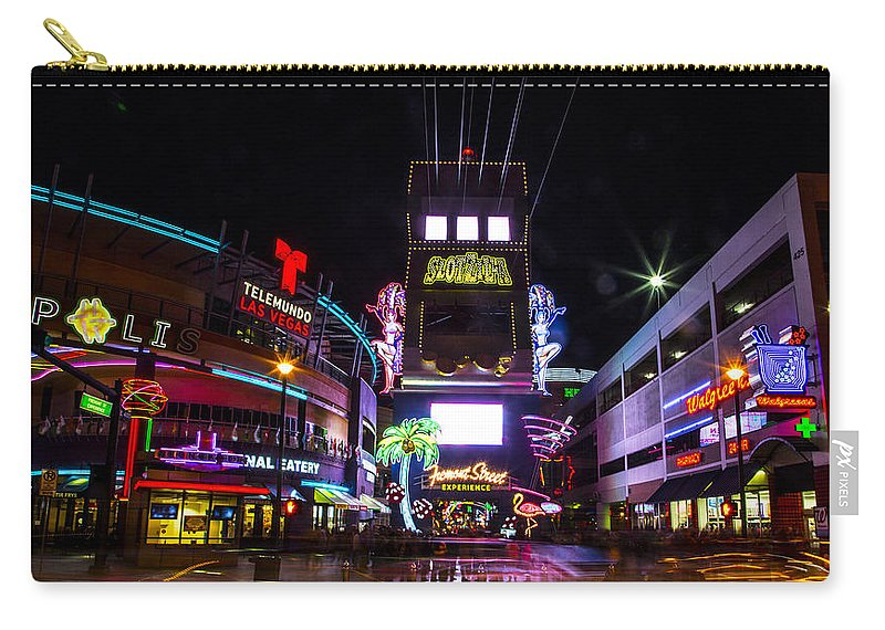 Las Vegas Carry-all Pouch featuring the photograph Entrance To The Experience by Angus Hooper Iii