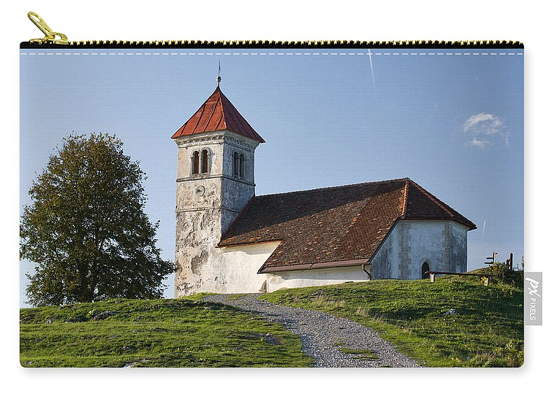 Saint Carry-all Pouch featuring the photograph Evening Glow Over Church by Ian Middleton