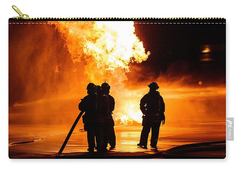 Extinguish Carry-all Pouch featuring the photograph Extinguish by Sennie Pierson