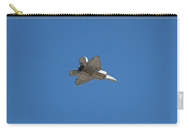 F22 Carry-all Pouch featuring the photograph F-22 Raptor In Flight Las Vegas II by Carl Deaville
