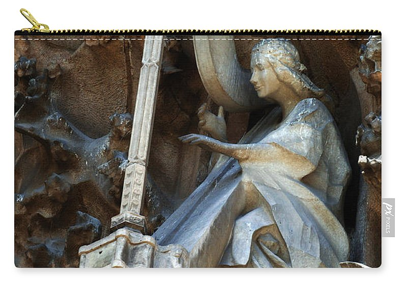 Passion Facade Carry-all Pouch featuring the photograph Facade Of Sagrada Familia by Bob Christopher