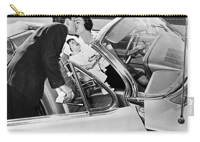 1956 Carry-all Pouch featuring the photograph Family Kiss by Underwood Archives