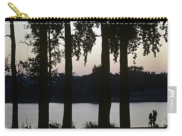Landscape Carry-all Pouch featuring the photograph Family Silhouetted By Lake by Jim Corwin