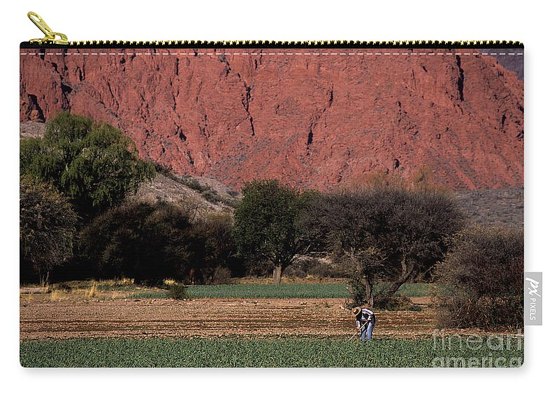 Argentina Carry-all Pouch featuring the photograph Farmer In Field In Northern Argentina by James Brunker