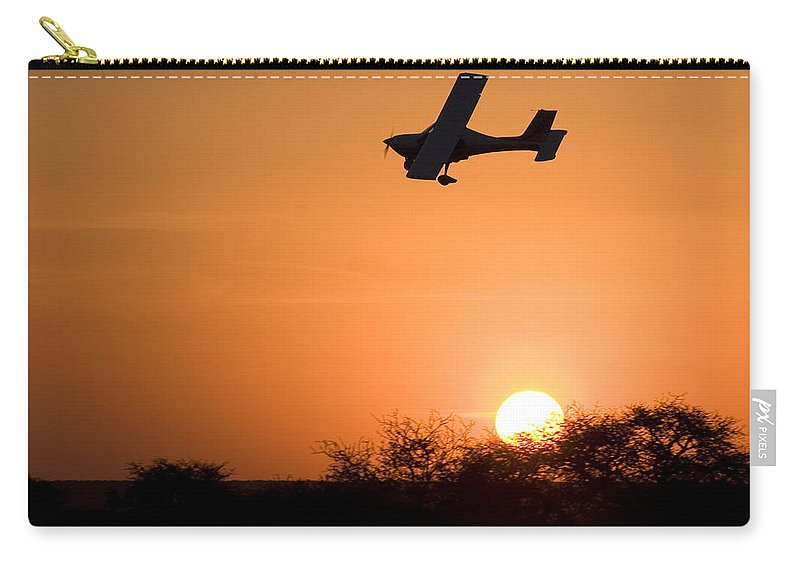Jabiru Carry-all Pouch featuring the photograph Fast And Low by Paul Job