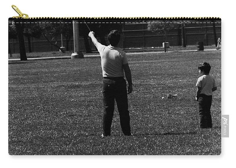 Father Carry-all Pouch featuring the photograph Father And Son by Karl Rose