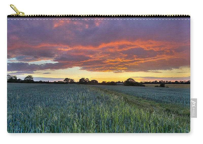Sunset Carry-all Pouch featuring the photograph Field At Sunset by Gary Eason