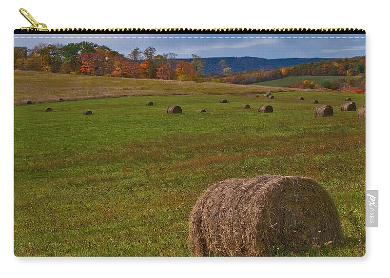Hay Carry-all Pouch featuring the photograph Field Of Round Bales by Timothy Flanigan Debbie Flanigan Nature Exposure