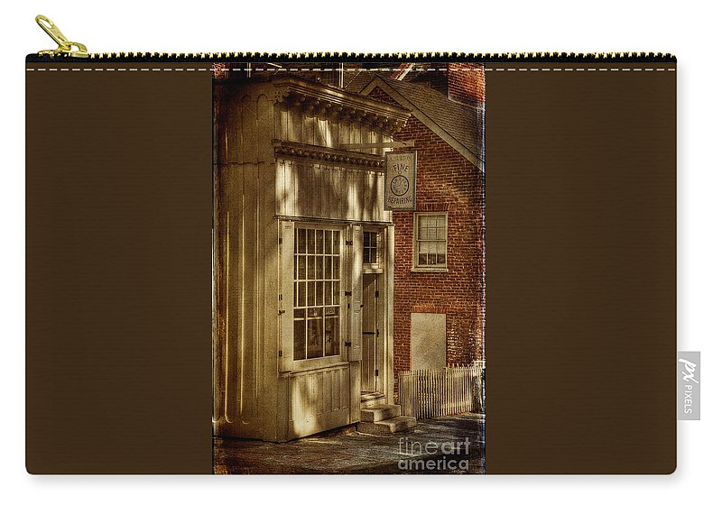 Store Carry-all Pouch featuring the photograph Fine Repairs by Lois Bryan