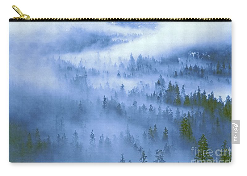 North America Carry-all Pouch featuring the photograph Fir Trees Shrouded In Fog In Yosemite Valley by Dave Welling