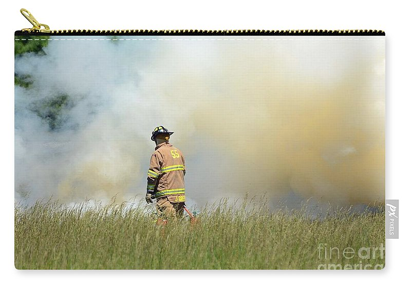 Fireman Carry-all Pouch featuring the photograph Firefighter 55 by Cindy Manero
