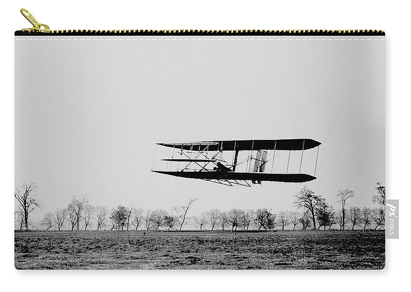 Kitty Hawk Carry-all Pouch featuring the photograph First In Flight by Benjamin Yeager