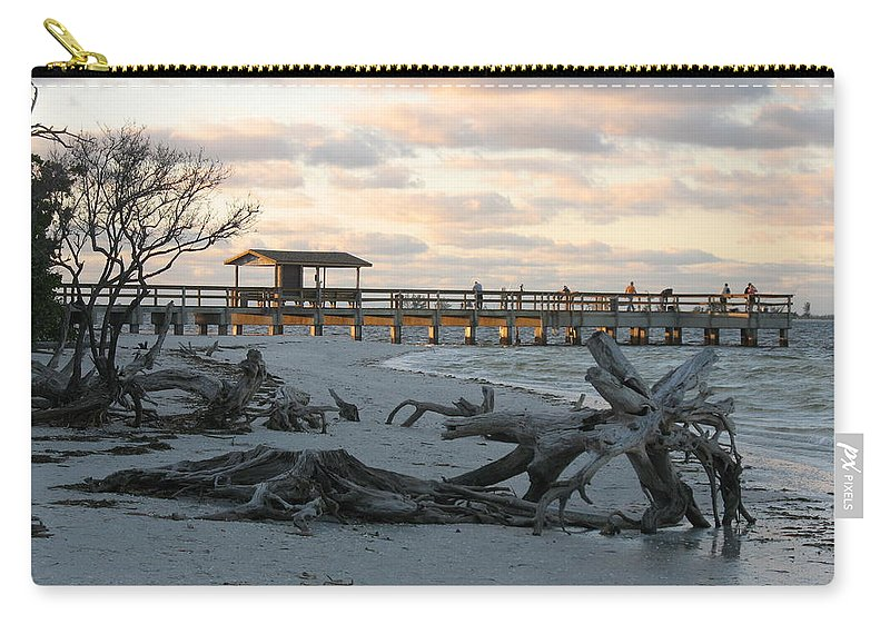 Fishing Pier Carry-all Pouch featuring the photograph Fishing Pier And Driftwood by Christiane Schulze Art And Photography