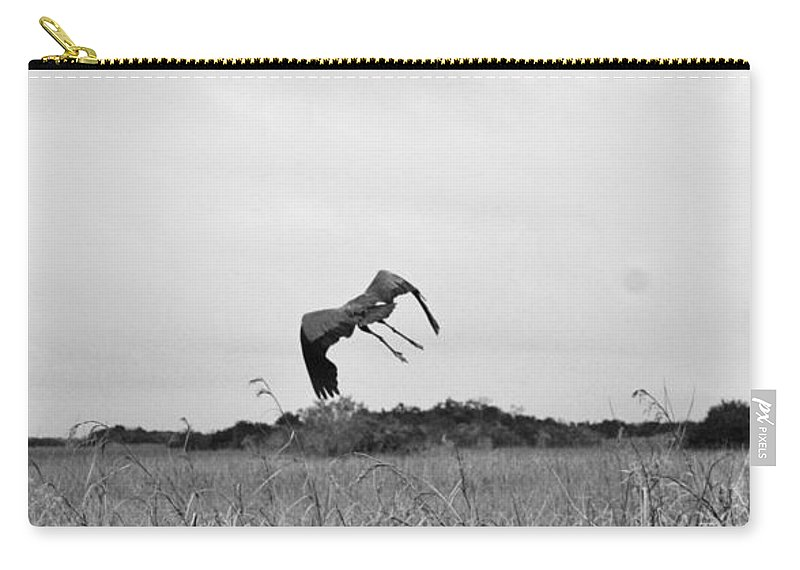 Heron Carry-all Pouch featuring the photograph Flight Over The River Of Grass by Chuck Hicks