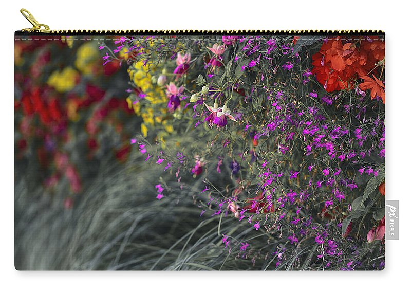Wall Of Flowers Carry-all Pouch featuring the photograph Flower Wall At The Falls Selective Color by Scott Campbell