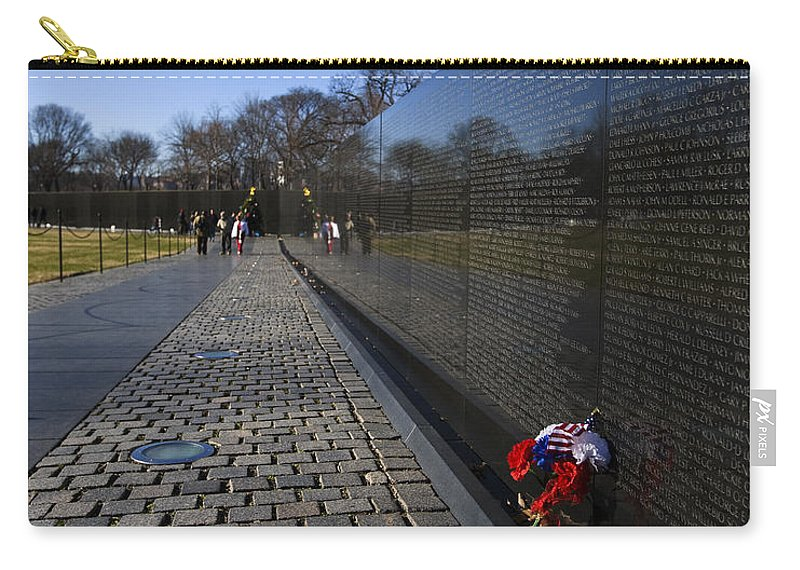 Flowers Carry-all Pouch featuring the photograph Flowers Left At The Vietnam War Memorial by B Christopher
