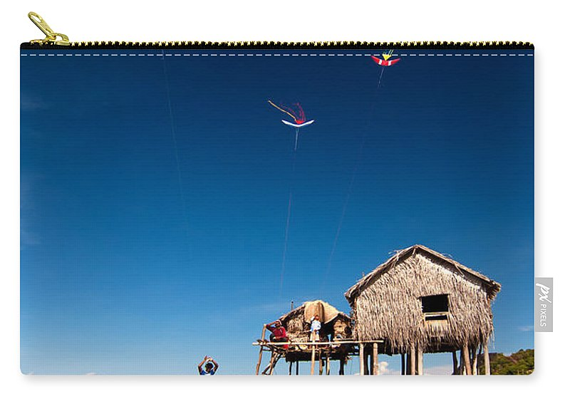 Flying Carry-all Pouch featuring the photograph Flying Kites by Kim Pin Tan