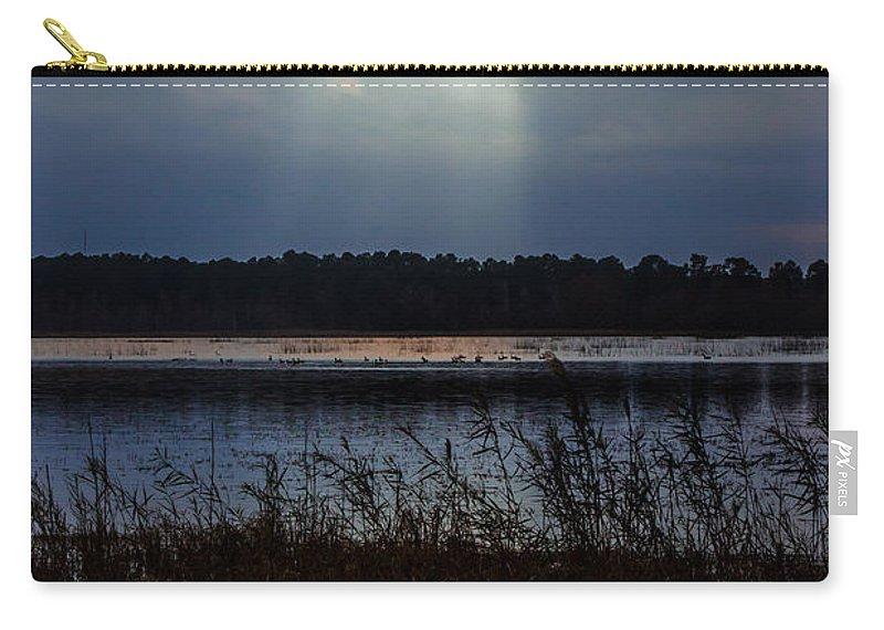 Follow Carry-all Pouch featuring the photograph Follow The Light by Scott Hervieux
