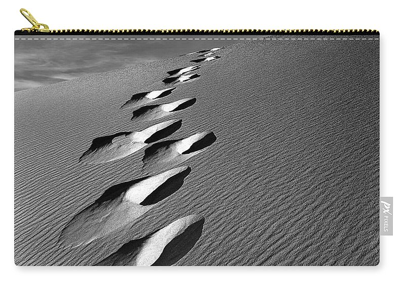 Footprints In Sand Carry-all Pouch featuring the photograph Footprints In Sand by Leland D Howard