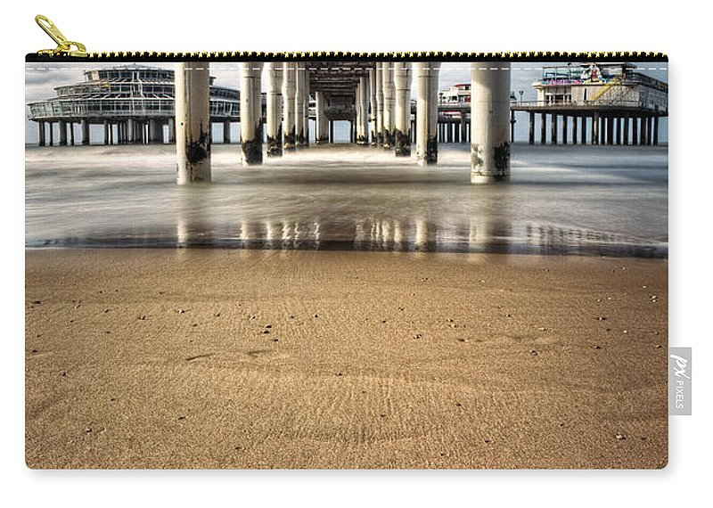 Piers Carry-all Pouch featuring the photograph Footprints In The Sand by Dave Bowman