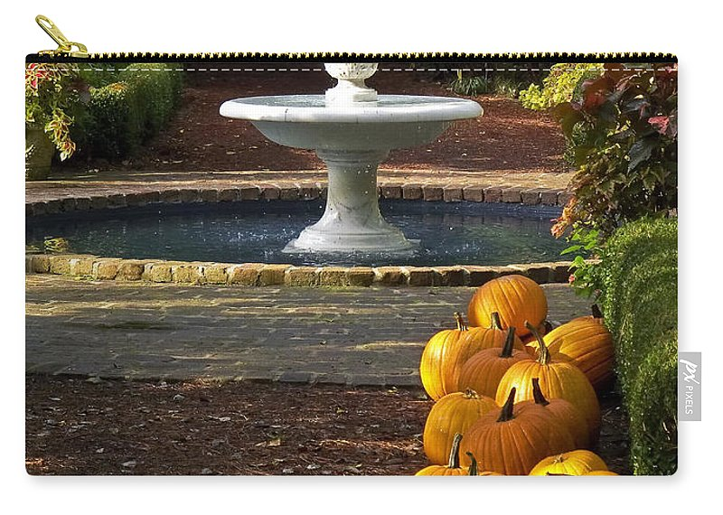 North Carolina Carry-all Pouch featuring the photograph Fountain And Pumpkins At The Elizabethan Gardens by Greg Reed
