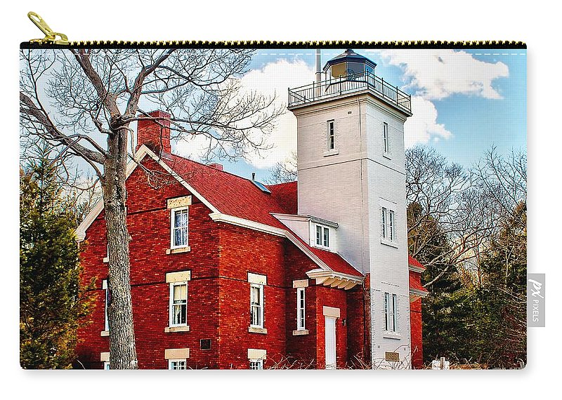Lighthouse Carry-all Pouch featuring the photograph Fourty Mile Point Lighthouse by Nick Zelinsky
