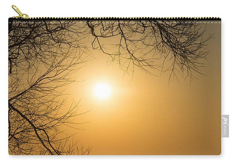 Golden Carry-all Pouch featuring the photograph Framing The Golden Sun by Georgia Mizuleva