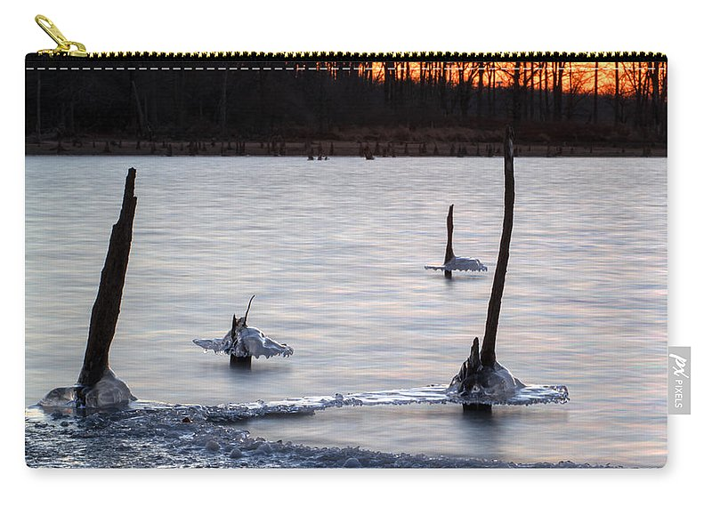 Ice Carry-all Pouch featuring the photograph Freezing Lake by Thomas Sellberg