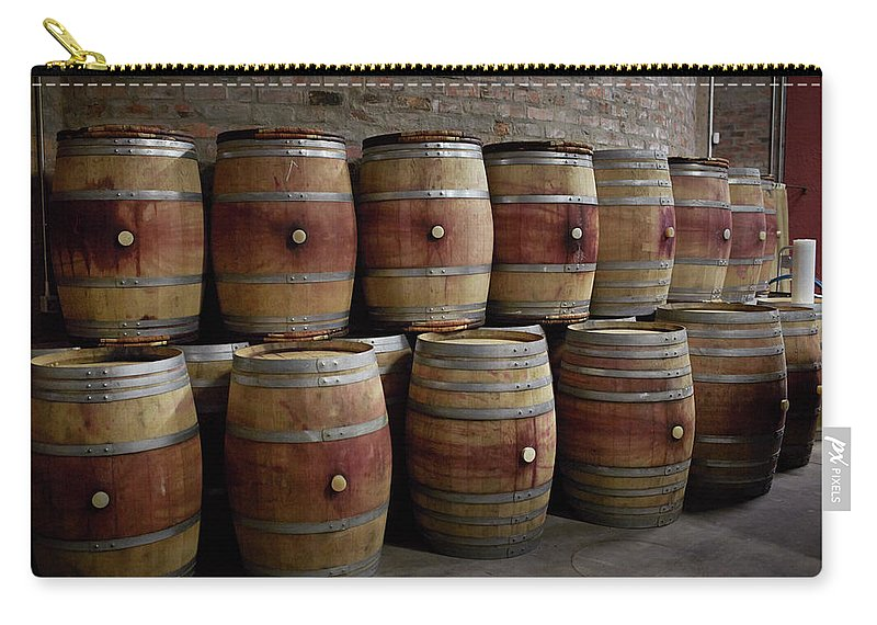 Stellenbosch Carry-all Pouch featuring the photograph French Wine Barrels Stacked At Winery by Klaus Vedfelt