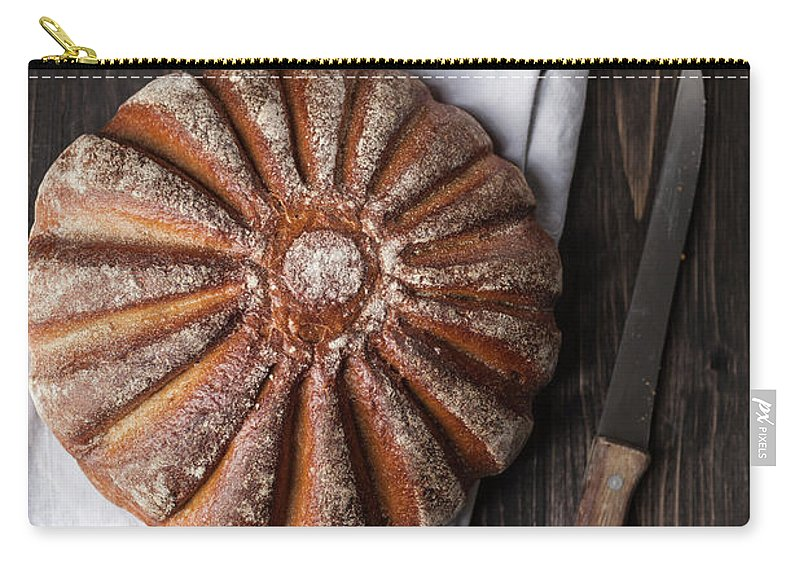 Kitchen Knife Carry-all Pouch featuring the photograph Fresh Baked Bread With Kitchen Knife On by Westend61