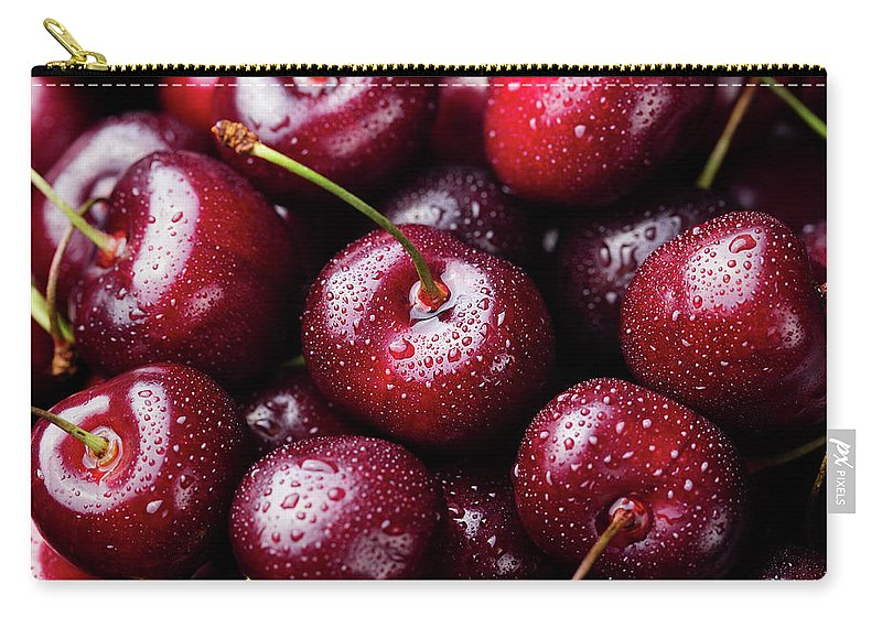 Cherry Carry-all Pouch featuring the photograph Fresh Ripe Black Cherries Background by Anna Pustynnikova