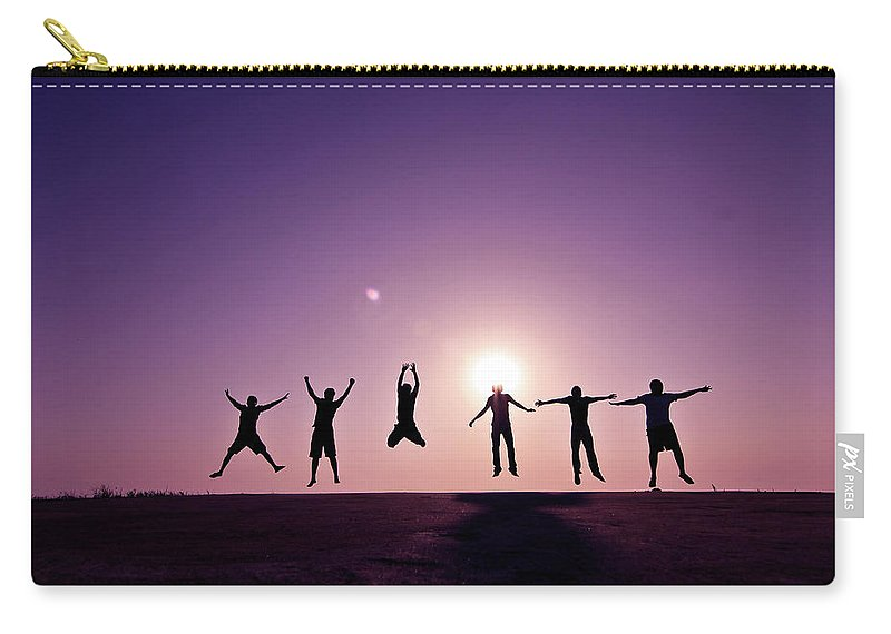 Human Arm Carry-all Pouch featuring the photograph Friends Jumping Against Sunset by Kazi Sudipto Photography