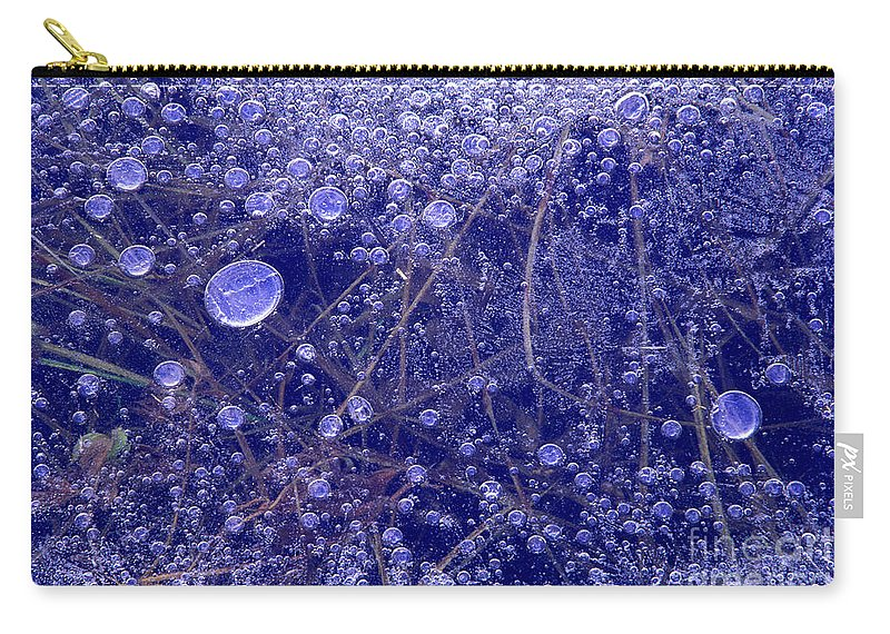 North America Carry-all Pouch featuring the photograph Frozen Bubbles In The Merced River Yellowstone Natioinal Park by Dave Welling