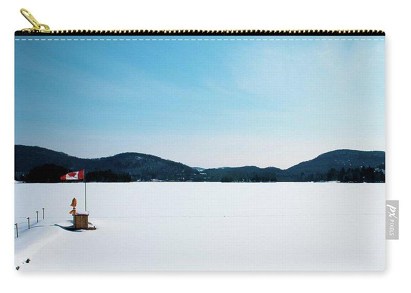 Scenics Carry-all Pouch featuring the photograph Frozen Lake In Canada by Haja Rasambainarivo