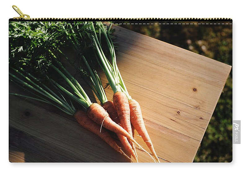 Five Objects Carry-all Pouch featuring the photograph Garden Carrots On Sunny Stool by Danielle D. Hughson