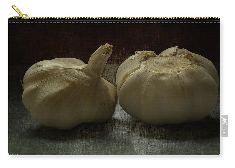 Garlic Carry-all Pouch featuring the photograph Garlic by Guna Andersone