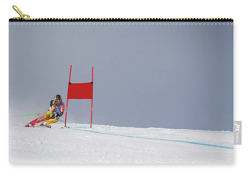 Skiing Carry-all Pouch featuring the photograph Giant Slalom Skier Rounds Gate At High by Ascent Xmedia