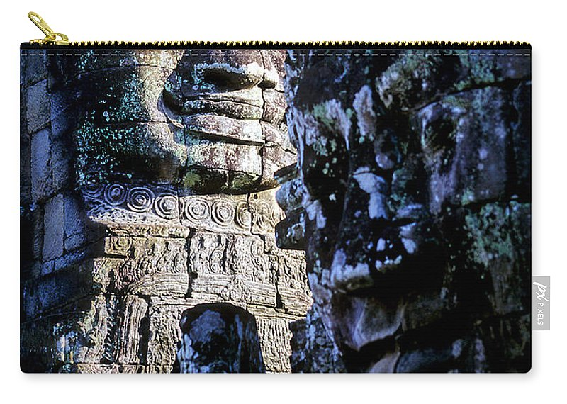 12th Century Architecture Carry-all Pouch featuring the photograph Gigantic Face Statues At Khmer Temple Angkor Wat Ruins Cambodi by Ryan Fox