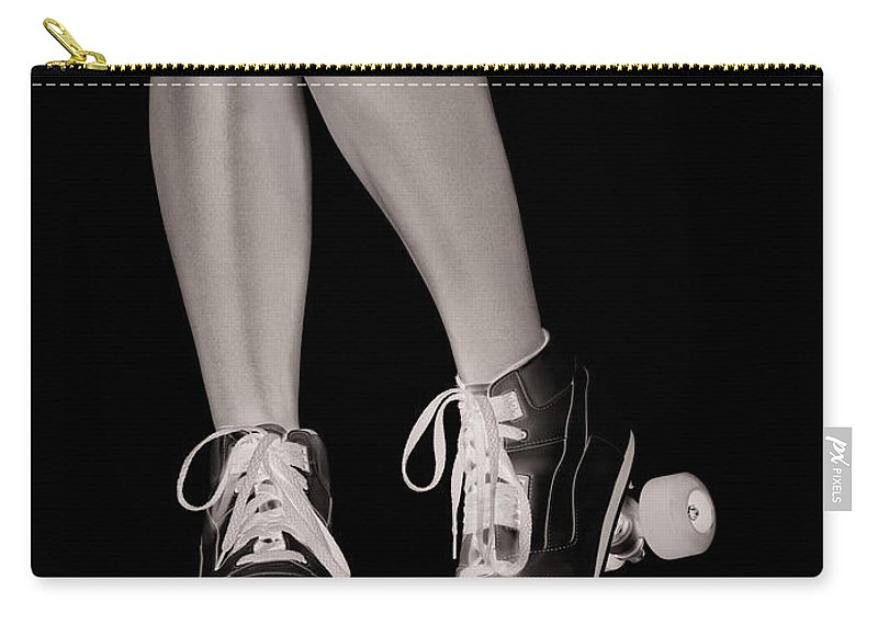 Roller Skates Carry-all Pouch featuring the photograph Girl Legs In Roller Skates Artistic Concept by Oleksiy Maksymenko
