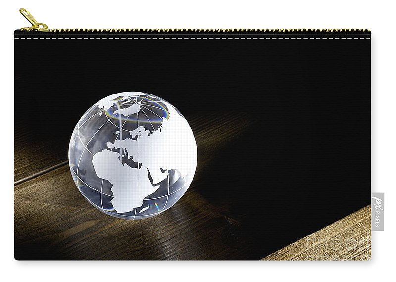 Globe Carry-all Pouch featuring the photograph Glass Globe On Wooden Floor by Simon Bratt Photography LRPS