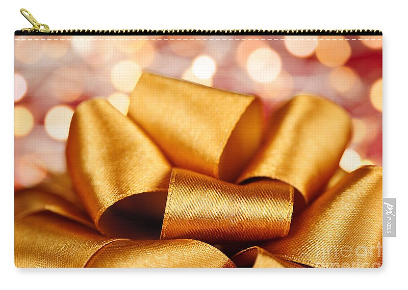 Gift Bow Carry-all Pouch featuring the photograph Gold Gift Bow With Festive Lights by Elena Elisseeva