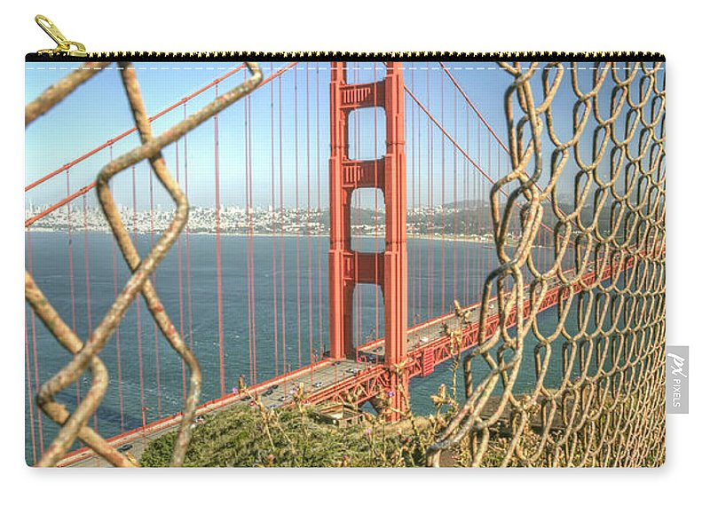 Golden Gate Carry-all Pouch featuring the photograph Golden Gate through the fence by Scott Norris