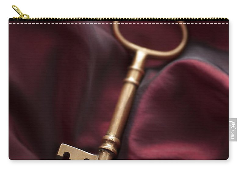 Key Carry-all Pouch featuring the photograph Golden Key On Silk by Lee Avison