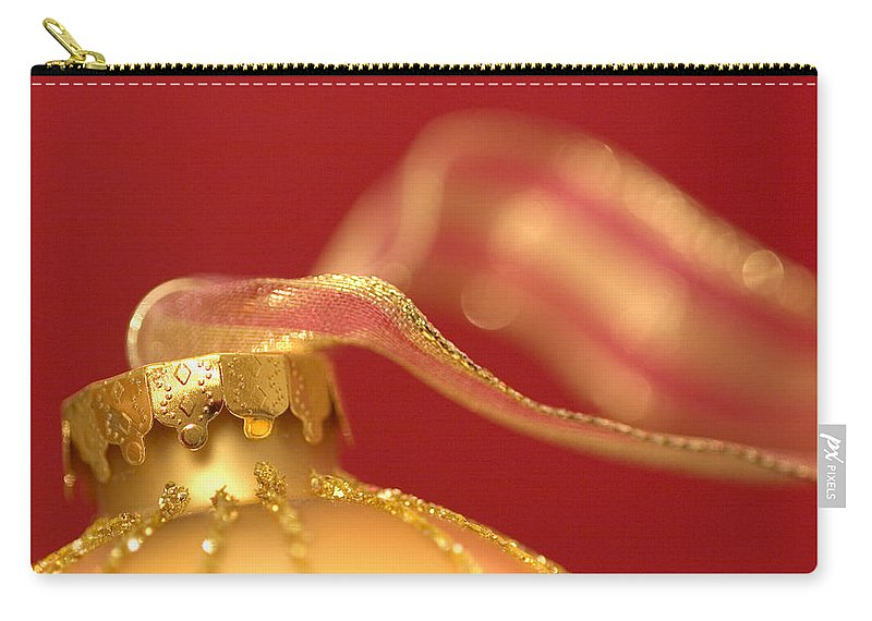 Christmas Carry-all Pouch featuring the photograph Golden Ornament With Striped Ribbon by Carol Leigh