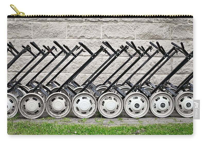 Bag-carrier Carry-all Pouch featuring the photograph Golf Carts by Tom Gowanlock