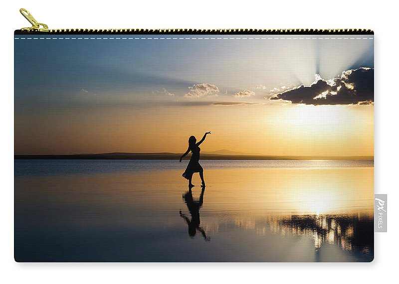 Ballet Dancer Carry-all Pouch featuring the photograph Grace At Sunset by Guvendemir