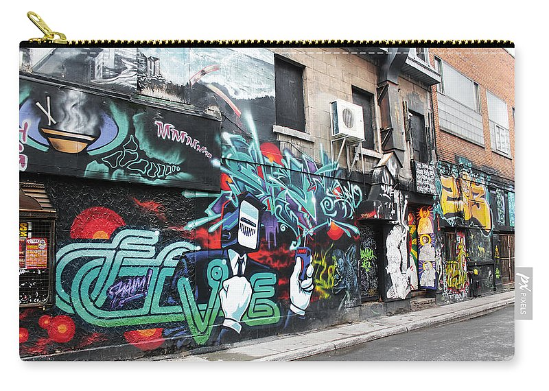Graffiti Carry-all Pouch featuring the photograph Graffiti Series 02 by Carlos Diaz
