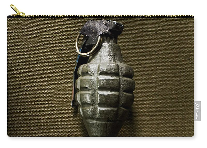 Grenade; Weapon; Military; War; Green; Pin; Destruction; Destructive; One; Still Life; Us; United States; Bomb; Wwii; World War Two; Camouflage; Olive; Explosive; Fireball; Missile; Projectile; Ammunition; Cartridge; Iron; Shadows; Imposing; Ominous; Foreboding; Canvas Carry-all Pouch featuring the photograph Grenade by Margie Hurwich